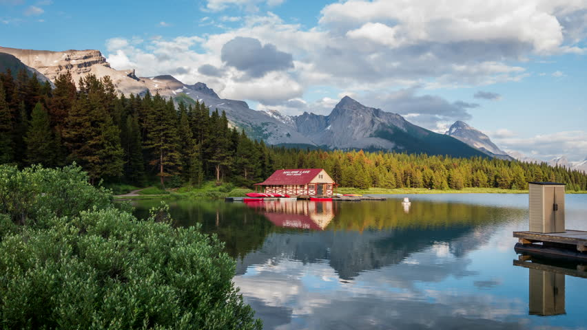 Time lapse view of Maligne Lake boat house at sunset in Jasper National Park, Alberta, Canada. Zoom in.