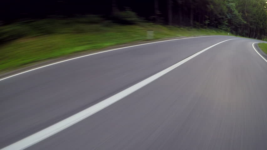 Point of view of a driving car on a asphalt road