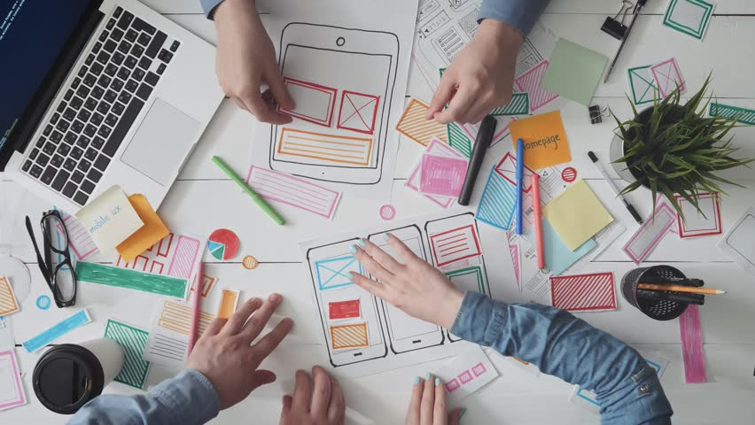 Small team of young UX designers creating mobile app layout | Shutterstock HD Video #1015227049