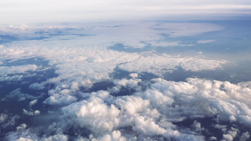 Flying over beautiful sky and clouds. Aerial view from airplane.   | Shutterstock HD Video #1015229233
