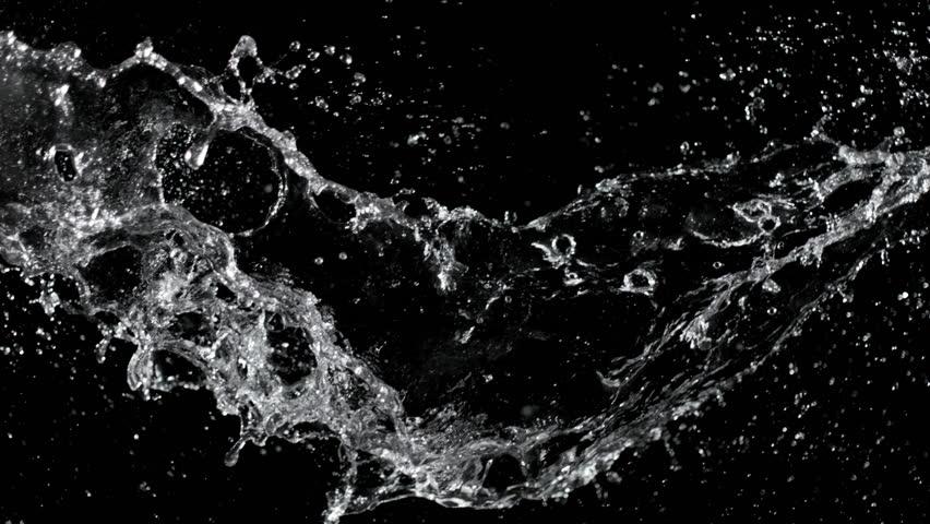 Super slow motion of water splash on black background. Filmed on high speed cinema camera, 1000 fps.