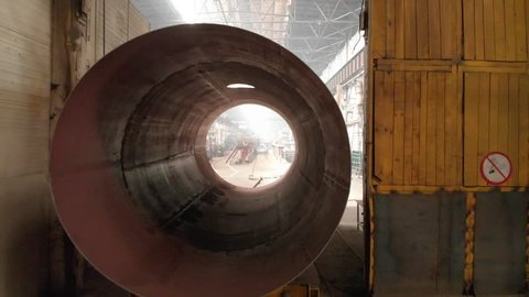 pipe metal texture inside going through. motion into huge metal pipe painted with yellow color at system assembled in gas and oil refinery plant workshop