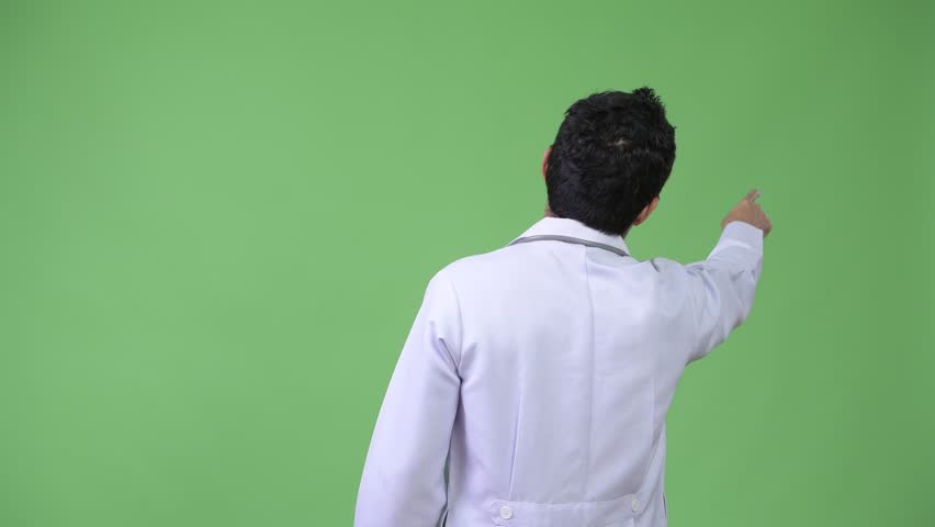 Rear view of Hispanic man doctor pointing finger | Shutterstock HD Video #1015300657