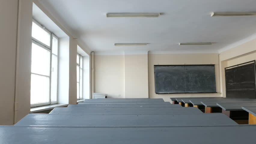 Desks in empty classroom, lecture hall in the College, School, University. The study hall represents lack of state funding  | Shutterstock HD Video #1015306093