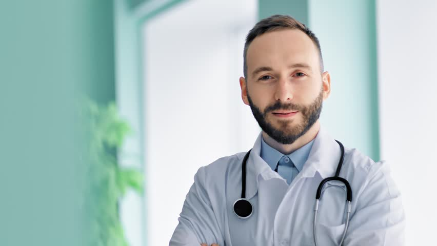 Close-up portrait confident male chief medical officer with beard and white lab coat