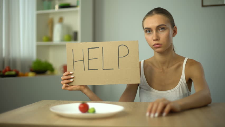 Help word written by depressed anorexic girl, starving body, eating disorder