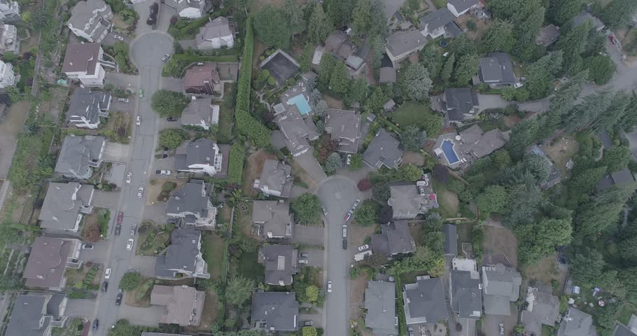 An aerial 4k D-Log footage of streets, cars and houses | Shutterstock HD Video #1015353133
