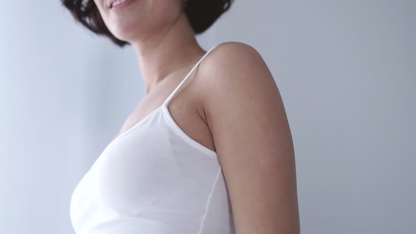 Skin Care. Woman Using Deodorant Spray For Armpit Skin