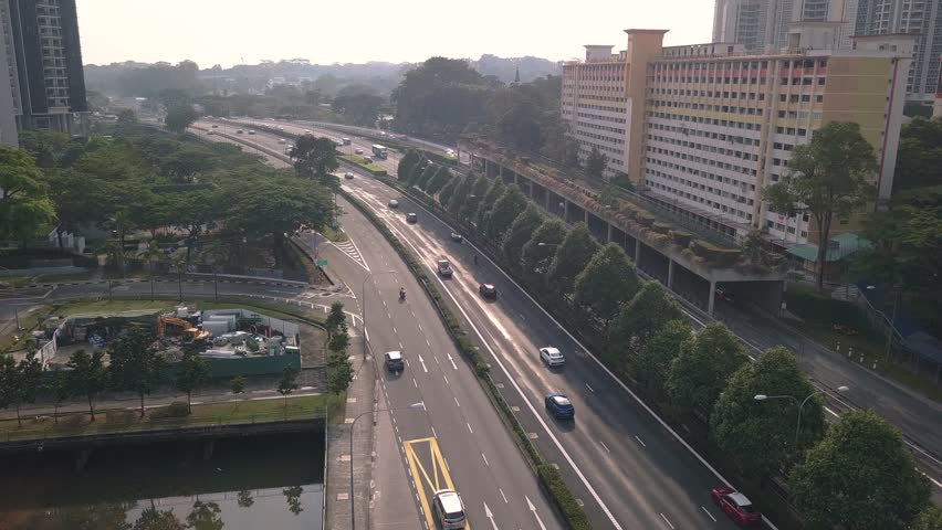 Low Level Aerial Shot Of Traffic On The Pan Island Expressway In Central Singapore In The Late Afternoon | Shutterstock HD Video #1015375684