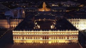 Palace of Versailles at night seen from the sky - Aerial Video