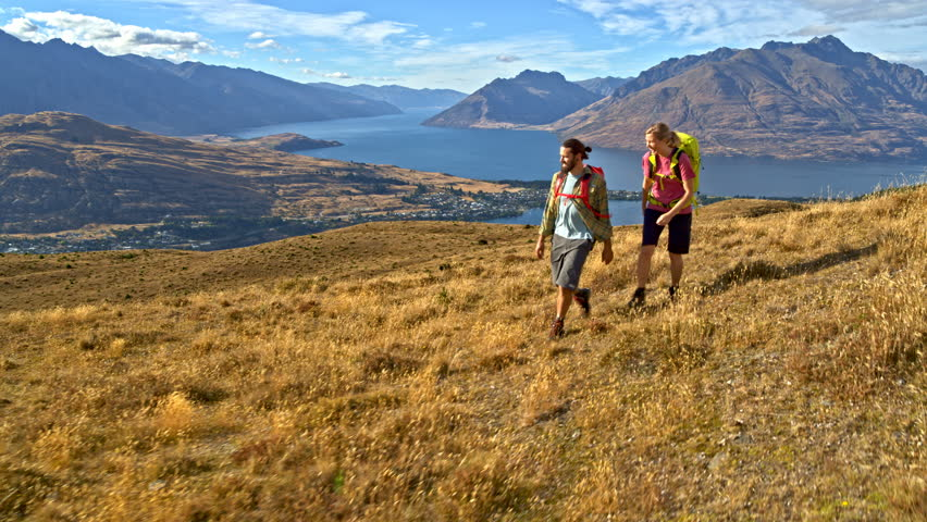 Aerial drone of young active Caucasian adventure hikers hiking to keep fit Mount Aspiring Lake Wakatipu New Zealand | Shutterstock HD Video #1015397818