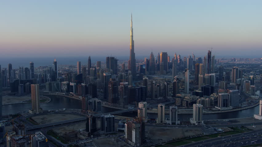 Aerial sunset city view Dubai Creek Downtown Business Bay commercial area modern vehicle transport highway United Arab Emirates Middle East Dubai RED WEAPON | Shutterstock HD Video #1015398916