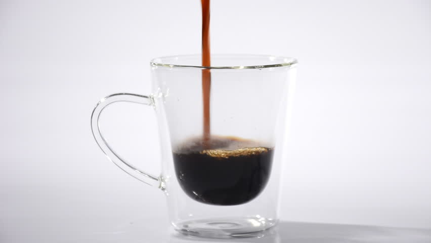 Pouring coffee into glass cup on white background | Shutterstock HD Video #1015419244