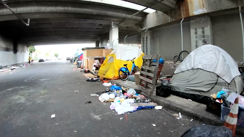 San Francisco, The United States of America - Jun 24, 2018: Tents and huts on a sidewalk in San Francisco, CA.