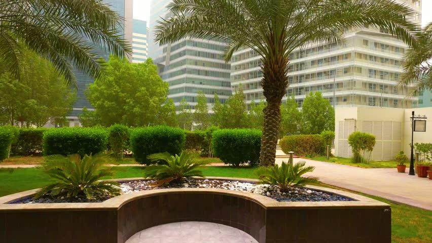 Abu Dhabi city small park as an entrance to an apartment building