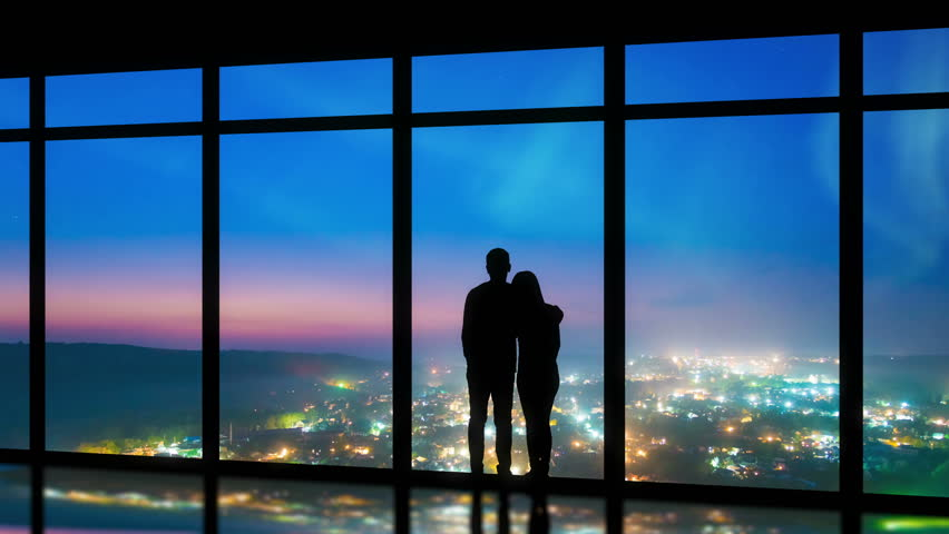 The couple standing near windows on the foggy city background. time lapse | Shutterstock HD Video #1015503424