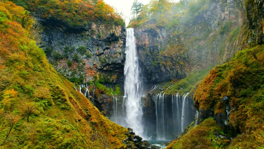 Kegon Waterfall in autumn trees colorful waterfall from lake Chuzenji in Nikko national park, Beautiful in autumn leaves (koyo) season at Tochigi ,Japan