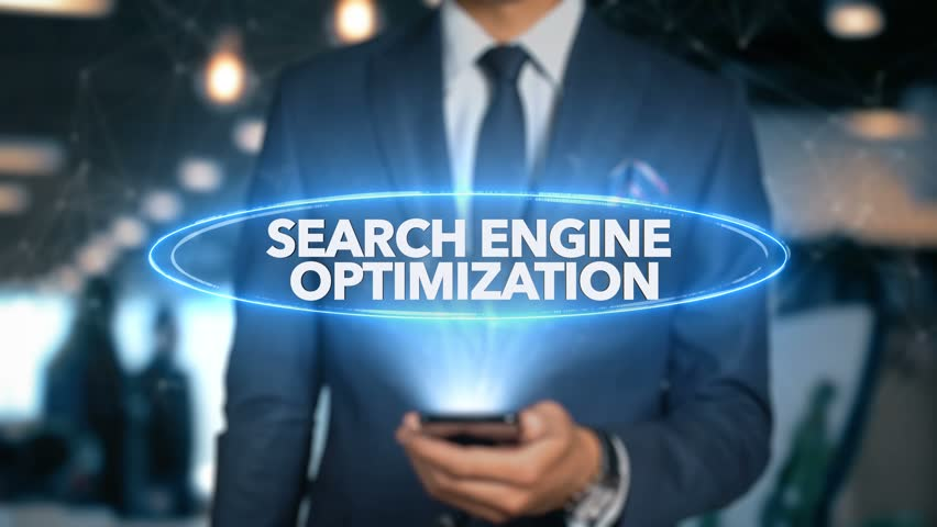Businessman With Mobile Phone Opens Hologram HUD Interface and Touches Word - SEARCH ENGINE OPTIMIZATION Royalty-Free Stock Footage #1015508236