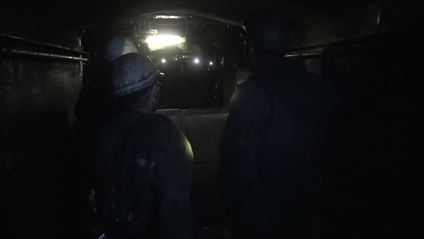 Miners climb out of the mine in an elevator cage | Shutterstock HD Video #1015540360