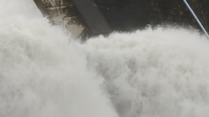 Big waterfall from dam. Rapid strong flow of water falls down in rainy.  | Shutterstock HD Video #1015554175