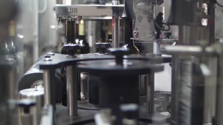 Wine bottles in conveyor belt  bottling line industry slow motion   Shutterstock HD Video #1015561801