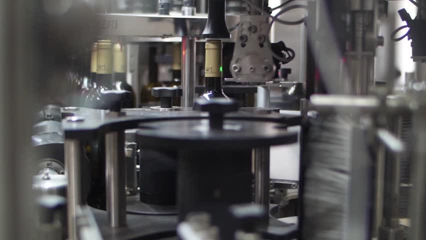 Wine bottles in conveyor belt  bottling line industry slow motion   Shutterstock HD Video #1015561804