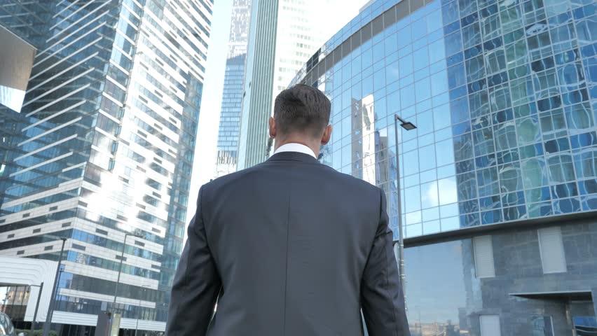 Walking Businessman, Back view ,  modren office building | Shutterstock HD Video #1015594864