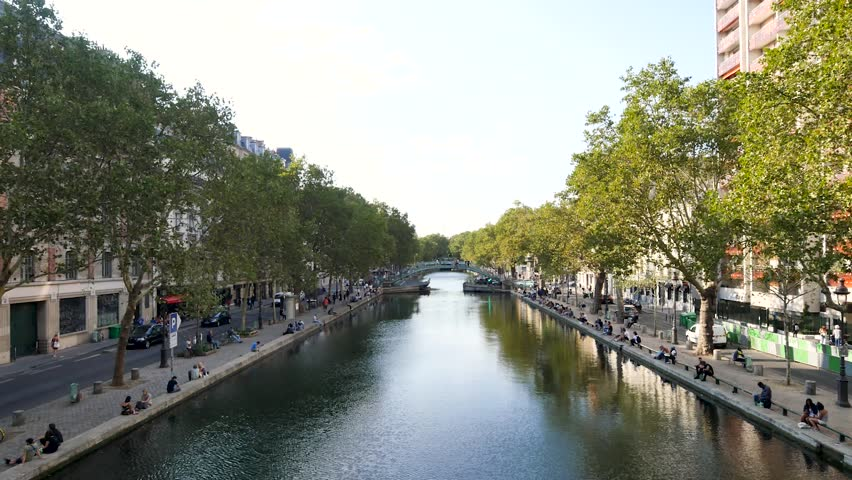 In the summer in Paris, Parisians and tourists come to rest at the edge of the saint-martin canal, in the east of the city. This place is known because it was used as scenery for films.