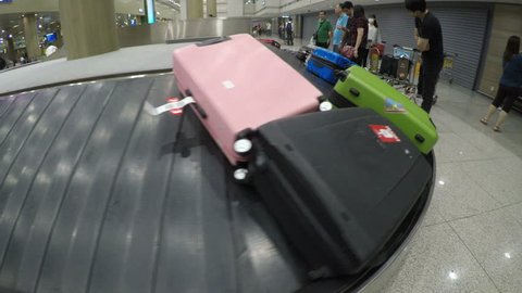 Incheon, South Korea-June 09, 2018 : Video super wide angle view of luggage suitcase on the conveyor wait for passenger come to take them in Incheon International Airport, South Korea
