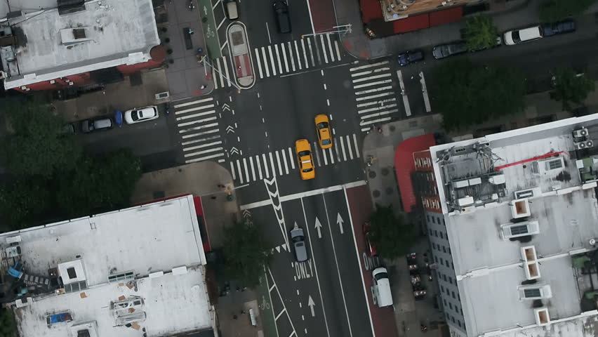 Overhead aerial of taxis driving on street, cab in New York City NYC 1080 HD