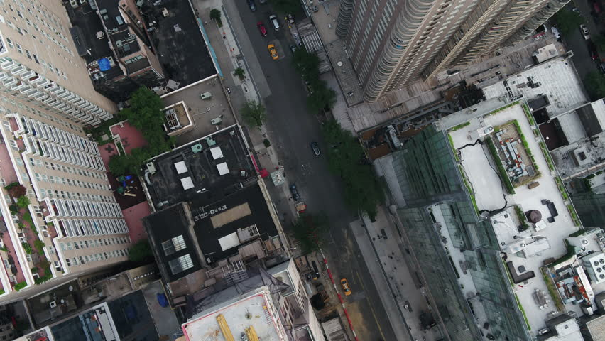 Overhead aerial cars driving in Midtown Manhattan traffic New York City NYC 4K 1080 HD | Shutterstock HD Video #1015620082