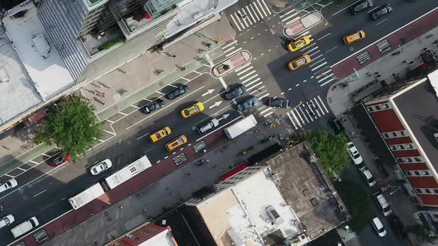 Overhead aerial diagonal cars driving in Midtown Manhattan traffic New York City NYC 1080 HD