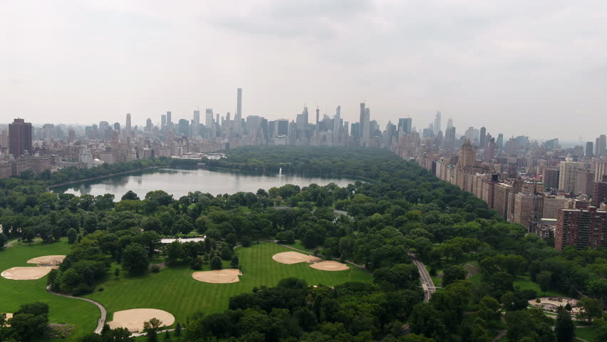 Central Park aerial pulling back over meadow New York City NYC 4K and 1080 HD