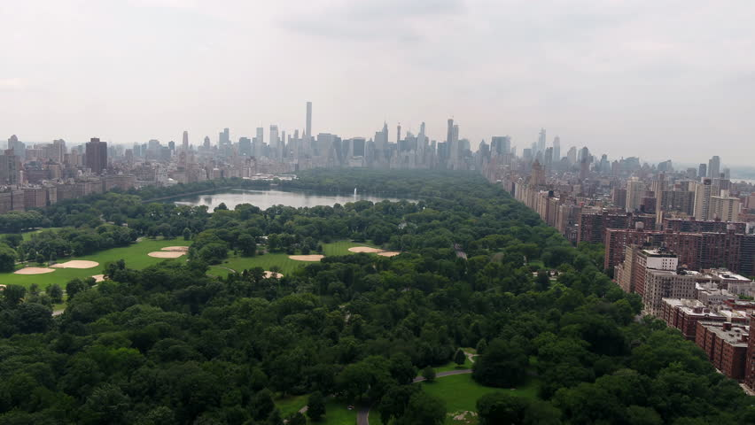 Central Park aerial moving forward over meadow New York City NYC 4K and 1080 HD