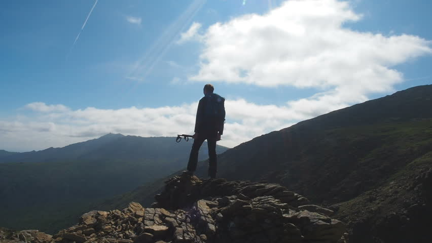 Hiker Tourist Man Travelling Mountains. Explore Adventure Travel Concept. Hiking Man Tourist Backpacker Trekking Mountains. Path Find Wanderlust Concept. Hiking Equipment Shoes Poles Backpack #1015637641