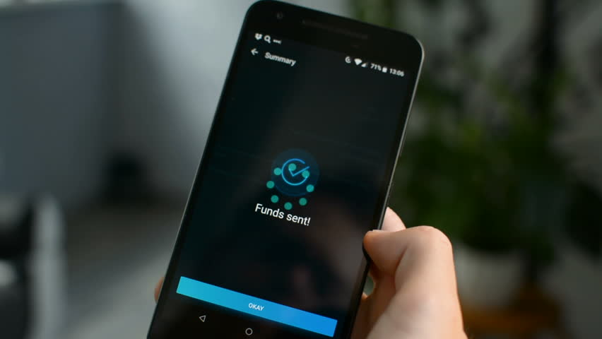 Funds Sent message, sending funds using Bitcoin cryptocurrency with mobile phone app concept