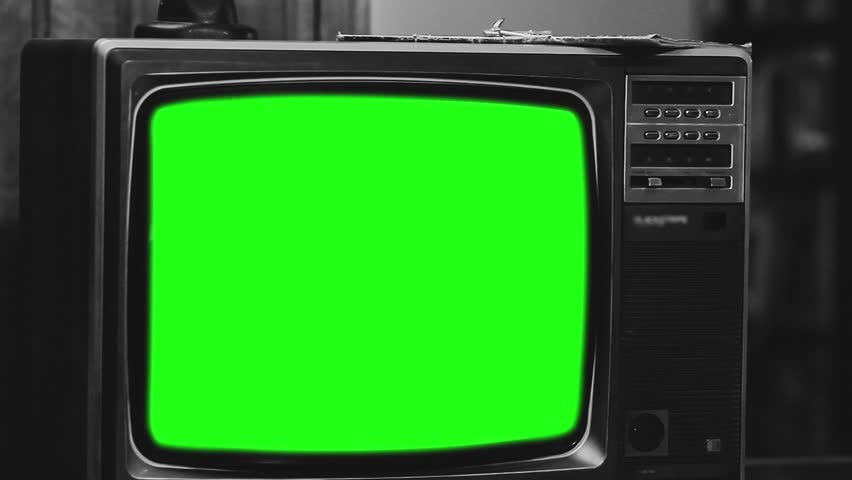 "Old Television with Green Screen. Black and White Tone. Slow Zoom Out. Ready to Replace Green Screen with any Footage or Picture you Want. You Can Do It With ""Keying"" (Chroma Key) Effect.   