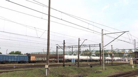 Oswiecim / Poland - July 2018: Railway station. The train travels on rails. 4K, UHD, 50p, Cinematic,Panning,Wide angle,