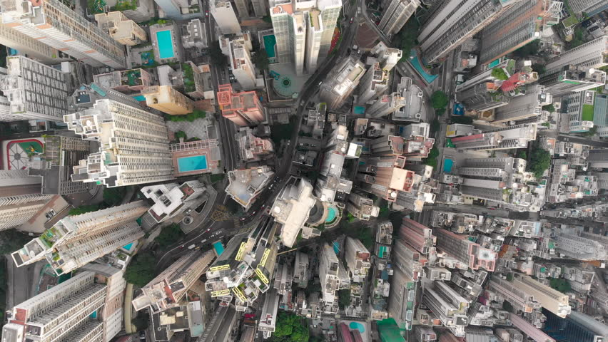 Aerial drone shot of congested building area of Hong Kong city and traffic #1015702525