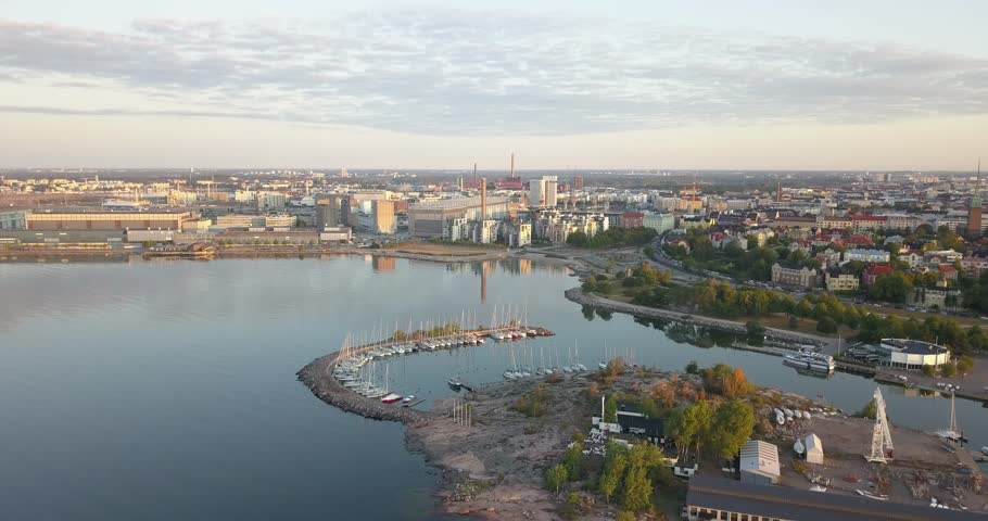 4K summer early morning aerial video of Helsinki Baltic Sea Finnish Bay lagoon, Sirpalesaari boat parking yacht club area, boats, calm water surface in the capital of Finland Suomi, northern Europe | Shutterstock HD Video #1015705366