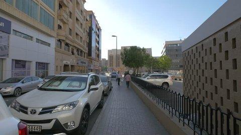 Dubai, United Arab Emirates - October, 2016: Parked cars on a street