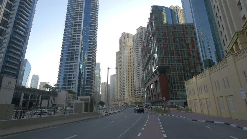 Dubai, United Arab Emirates - May, 2016: Cars driving on Al Sufouh Road in Dubai Marina | Shutterstock HD Video #1015746013