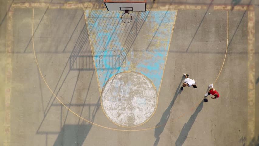 Aerial view of two young friends playing basketball on court outdoors. | Shutterstock HD Video #1015752253