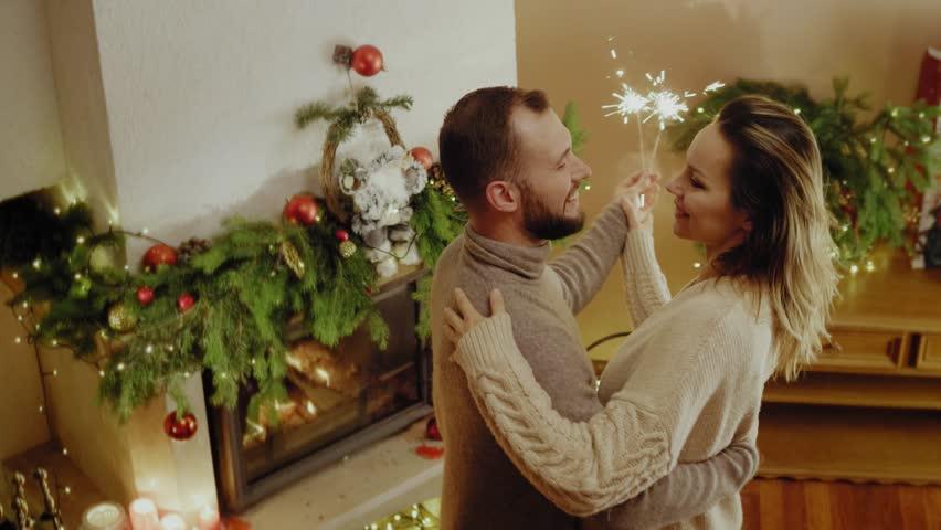 Happy beautiful couple celebrating Christmas
