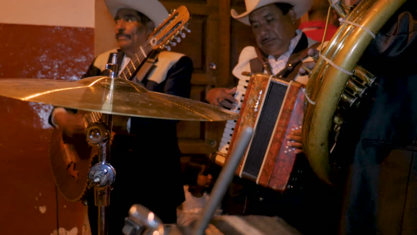PATZCUARO, MEXICO - SEPTEMBER 15 2016 - Mexican mariachi musicians including a tuba, accordion, and guitar playing on the streets during Mexican Independence Day with audio