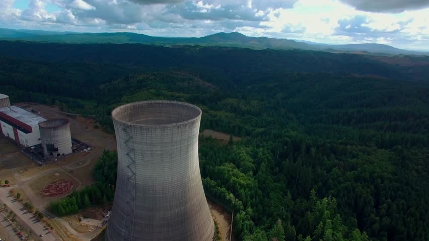 Flying over the cooling tower of an unfinished nuclear power plant