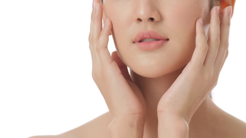 Close up beauty portrait of beautiful young asian woman touching face and healthy skin in slow motion skincare concept shot against pure white background | Shutterstock HD Video #1015780591