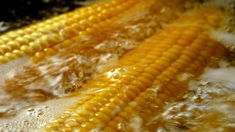 corn is boiled in boiling water close-up
