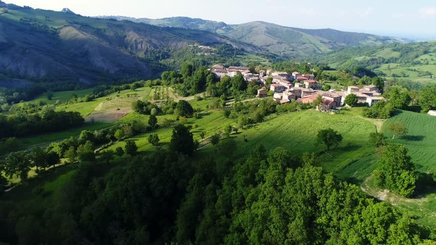 Aerial view of the medieval village of Bergogno of the Reggio Emilia Apennines | Shutterstock HD Video #1015786768