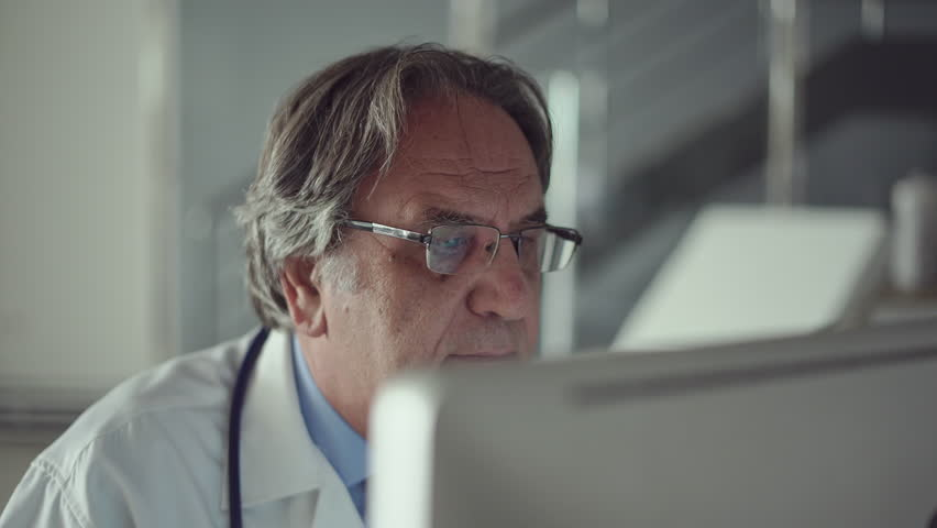Doctor working with laptop computer